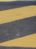 Road surface with painted yellow chevrons on it